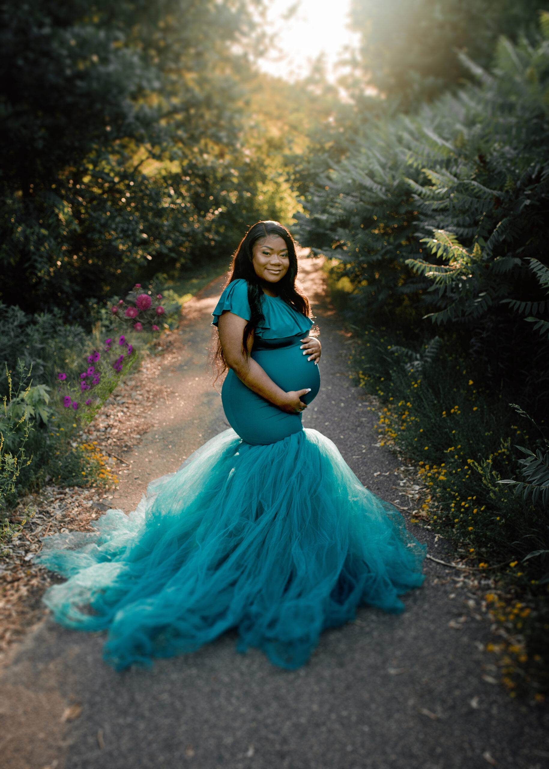 teal tulle mermaid gown by chicaboo for maternity session in Longfellow Gardens in Minneapolis MN