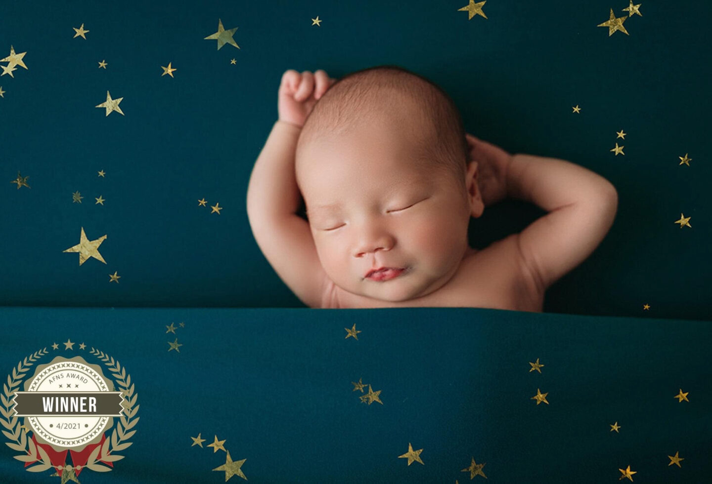 baby boy on star fabric background in minneapolis newborn session