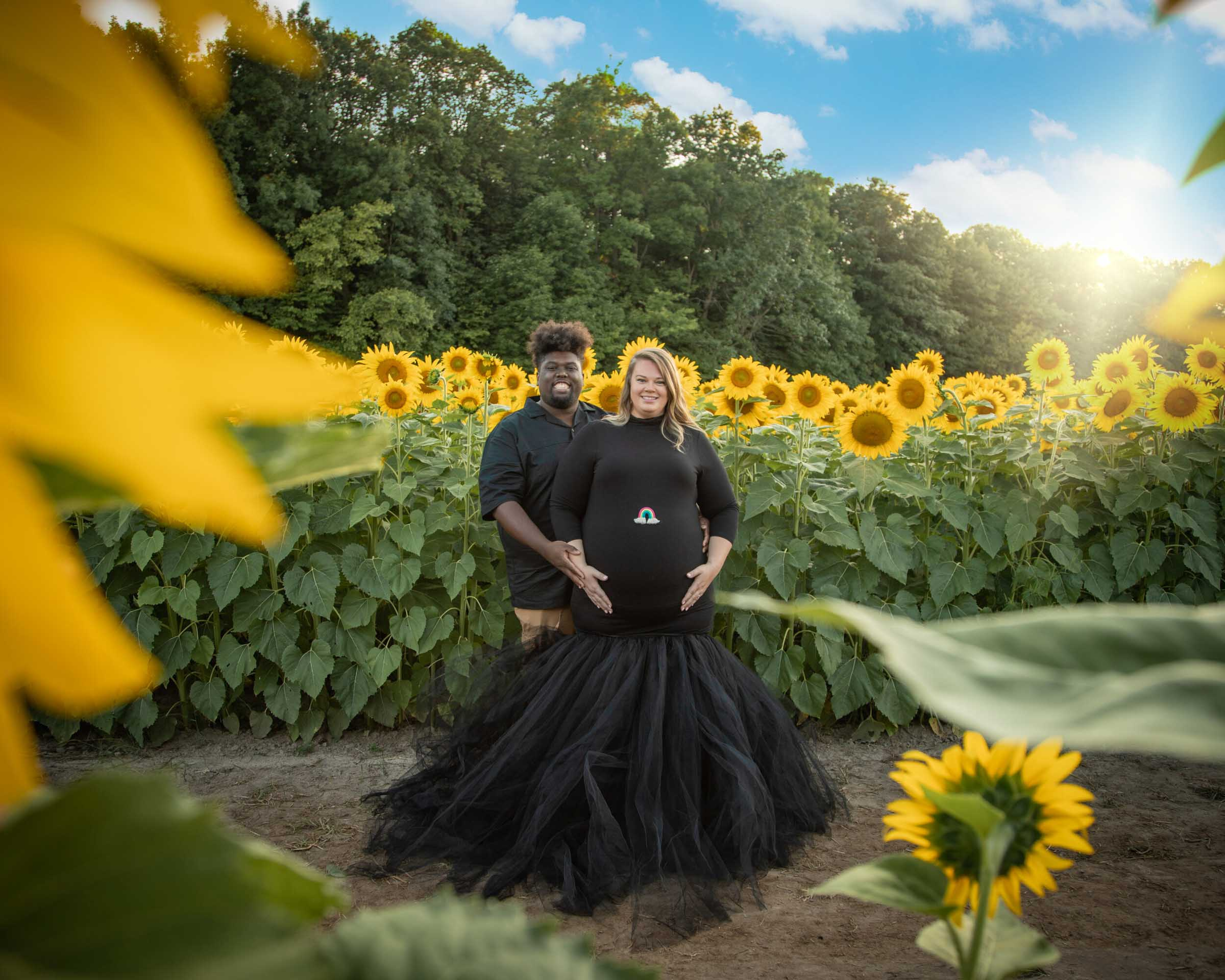 maternity session in sunflower field and black tulle gown minneapolis maternity photographer