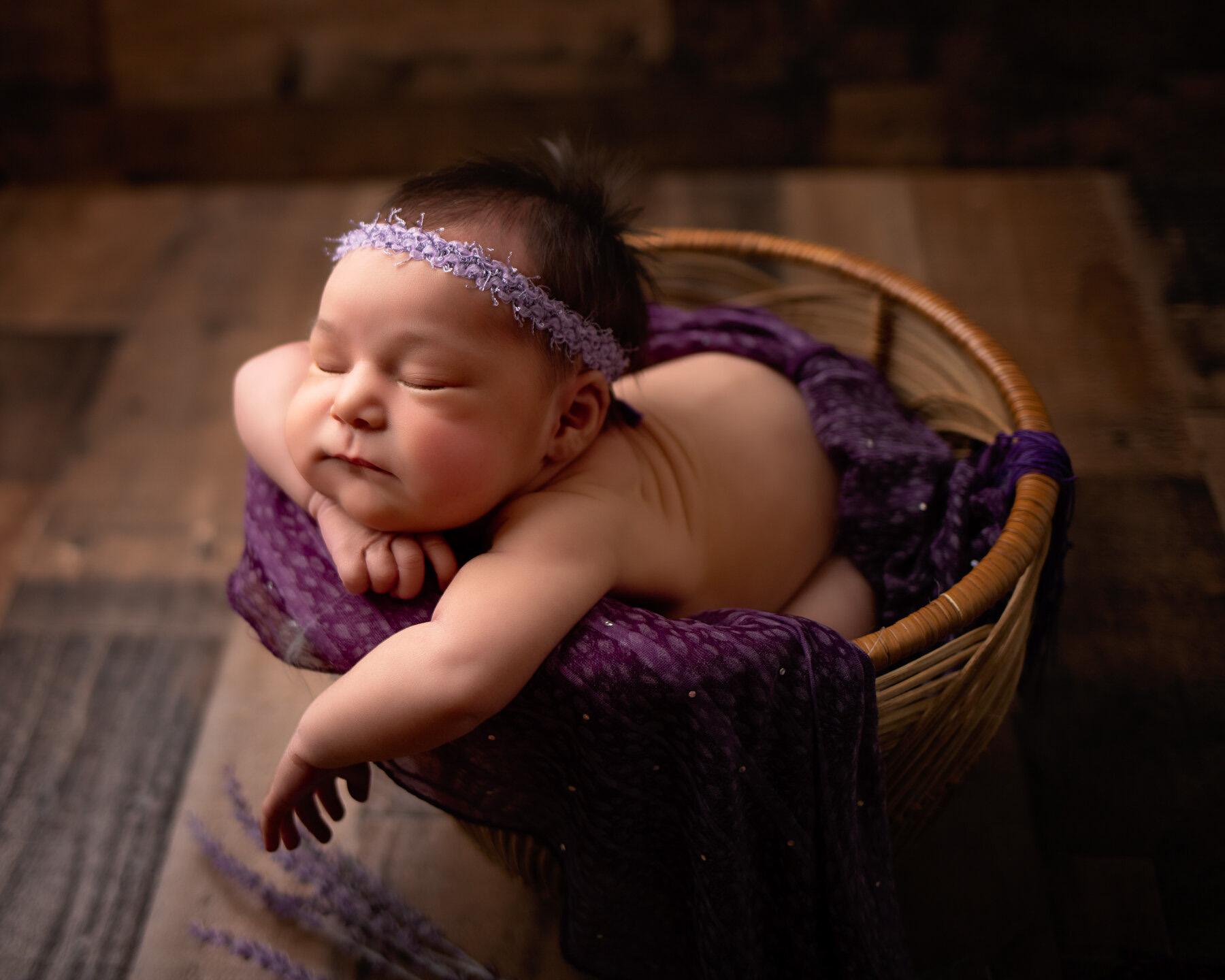 baby girl in purple lavender basket for minneapolis newborn photographer