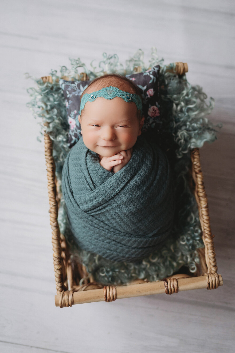 potato pose in teal with baby girl for newborn photography session in minneapolis mn