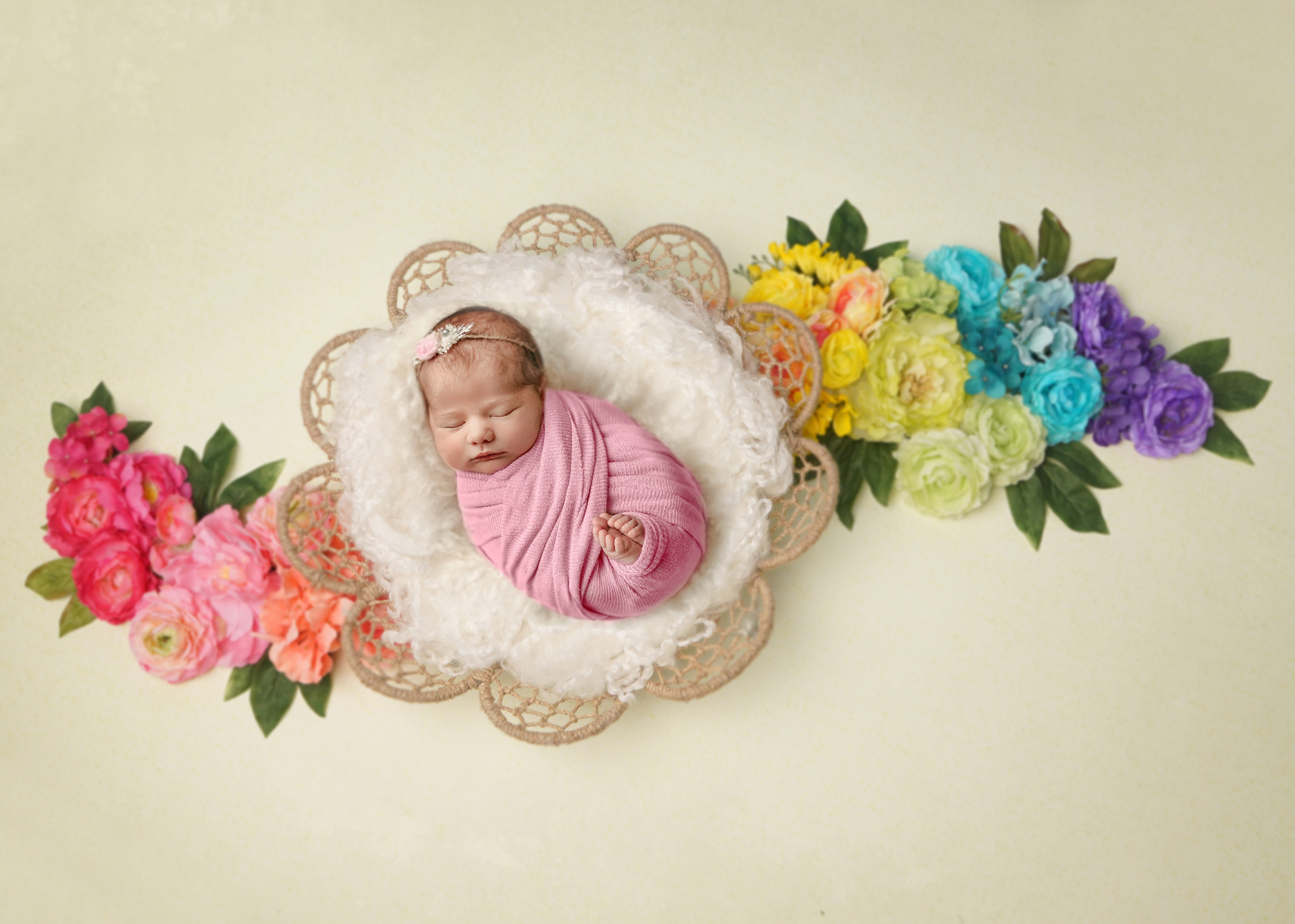 rainbow baby in dreamcatcher bowl with flowers for classic newborn photography session